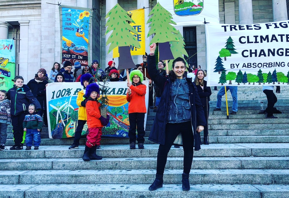 caption:  Jamie Margolin (foreground) and other young climate activists in Olympia on Monday