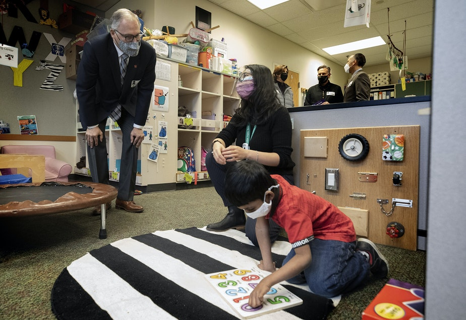 caption: Washington State Governor Jay Inslee speaks with special ed Pre-K teacher Michelle Ling in her classroom at Phantom Lake Elementary School in Bellevue, Wash. Tuesday, March 2, 2021.