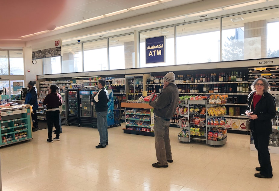 caption: This photo captures social distancing in action at a Seattle Walgreens. Public Health authorities have called on people to stay at least 6 feet away from each other, in order to prevent the spread of coronavirus.