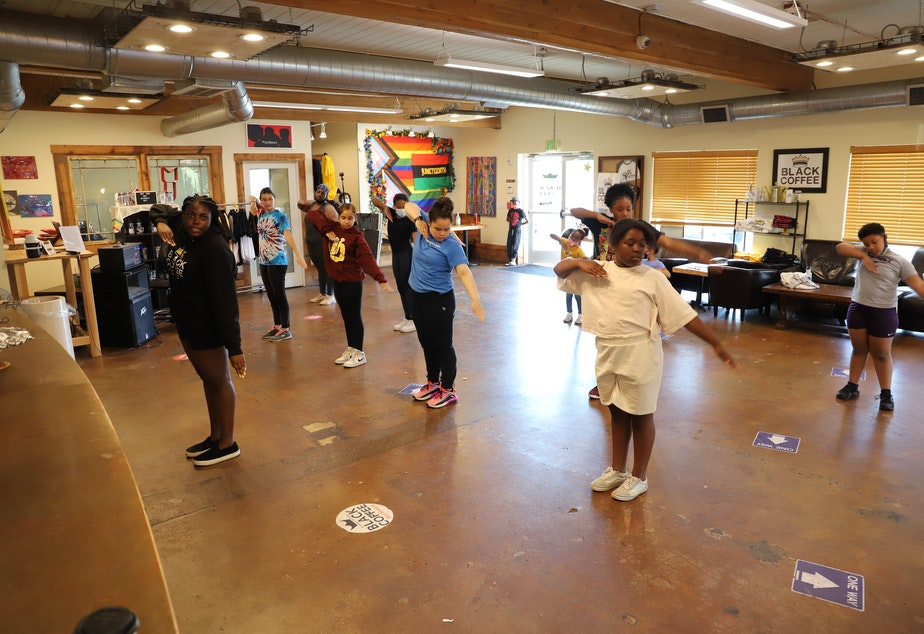 caption: Mikayla Weary (front) leads the step team at Black Coffee Northwest.