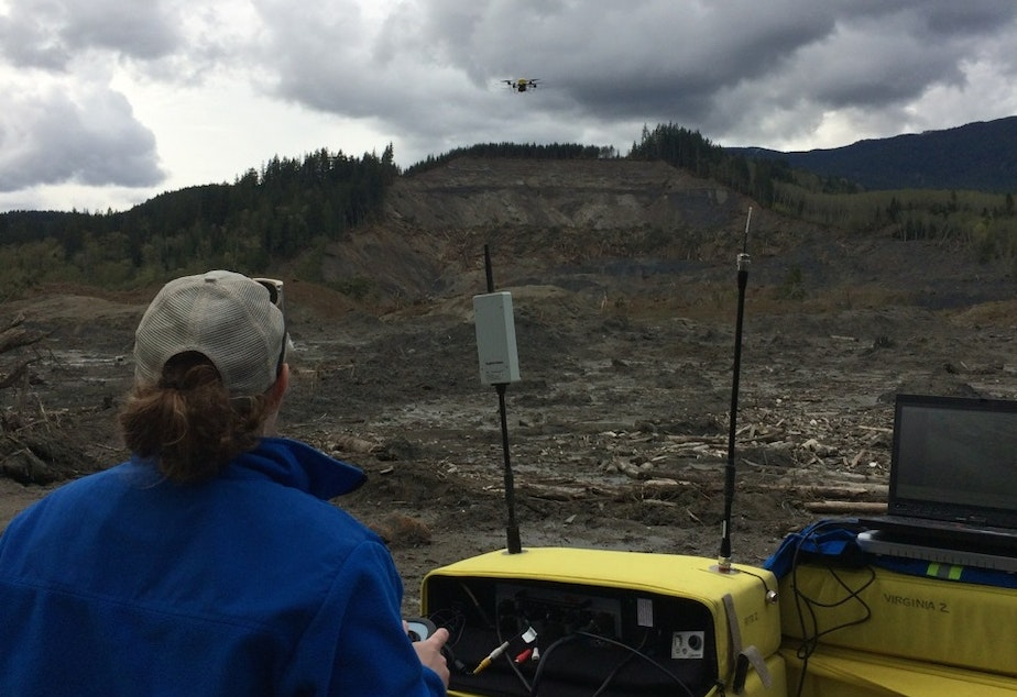 Brittany Duncan of Roboticists Without Borders flies a drone to survey the Oso mudslide on April 23, 2014.