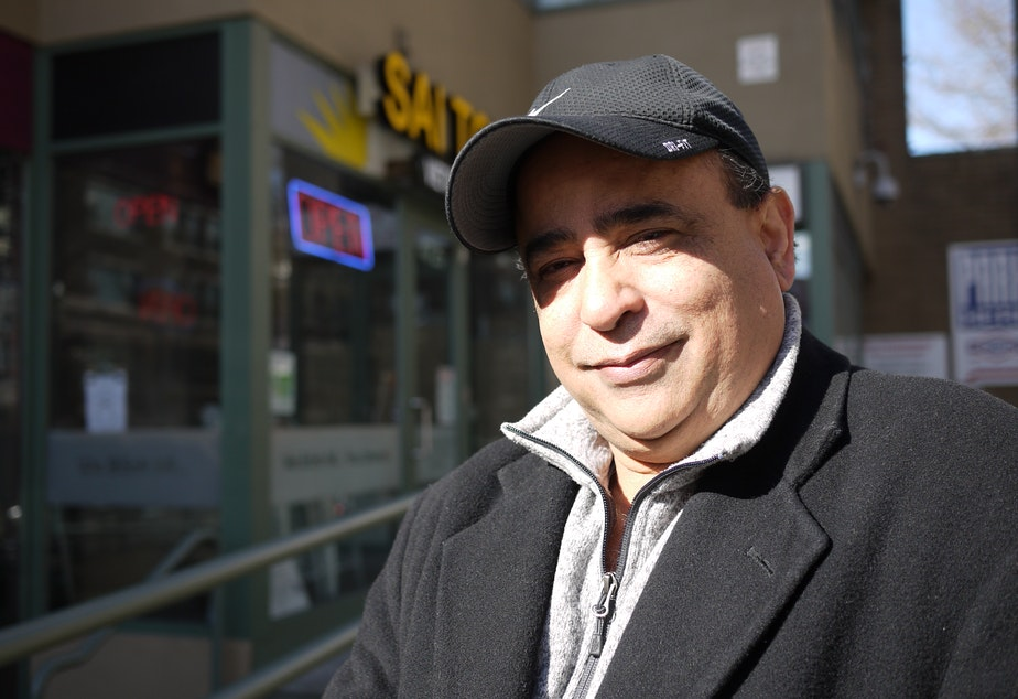 caption: Rizwan Samad, president New Wave Travel, outside his Seattle office.