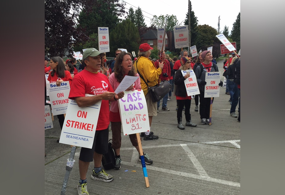 caption: At Roosevelt High School, teachers sang along to union anthems, led by the Seattle Labor Chorus on Monday, Sept. 14 -- day four of the strike.