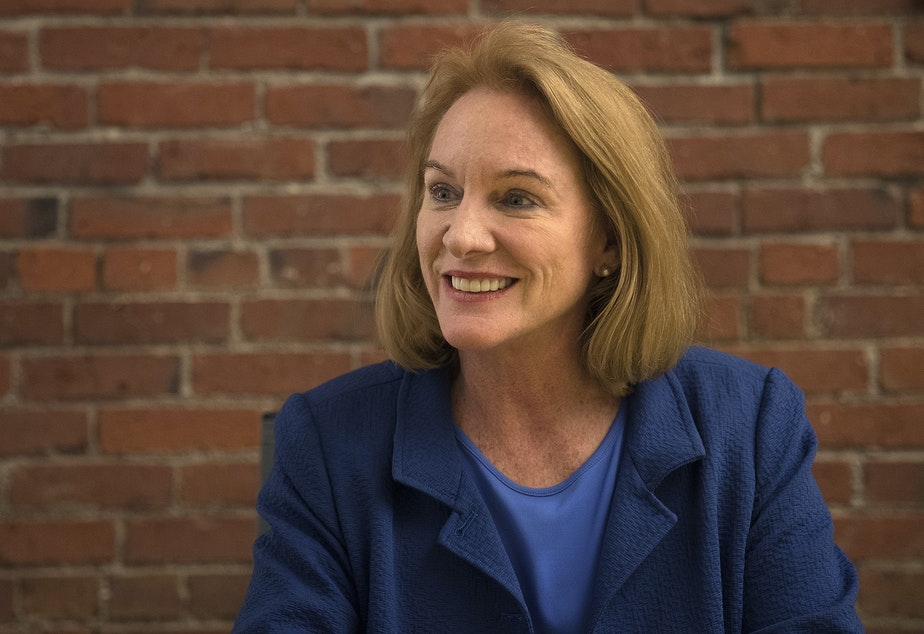 caption: Jenny Durkan talks to KUOW reporter Amy Radil on Wednesday, June 28, 2017, on 1st Ave. South, in Seattle, Washington.