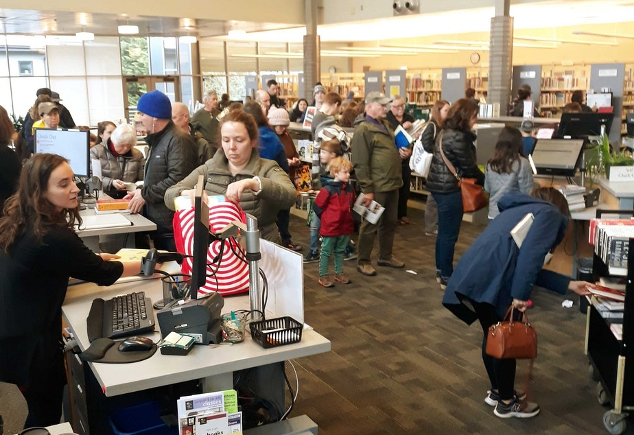 caption: The Greenwood branch library in north Seattle opened at 10 a.m. on Friday, the last day before a month-long closure due to COVID-19, and the masses flooded in -- despite public health warnings to stay away from spaces with many people.