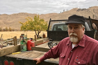 Rancher Dave Creveling believes the cost of a new Washington state carbon fee would be passed along to rural people like him if voters approve it. CREDIT: ASHLEY AHEARN