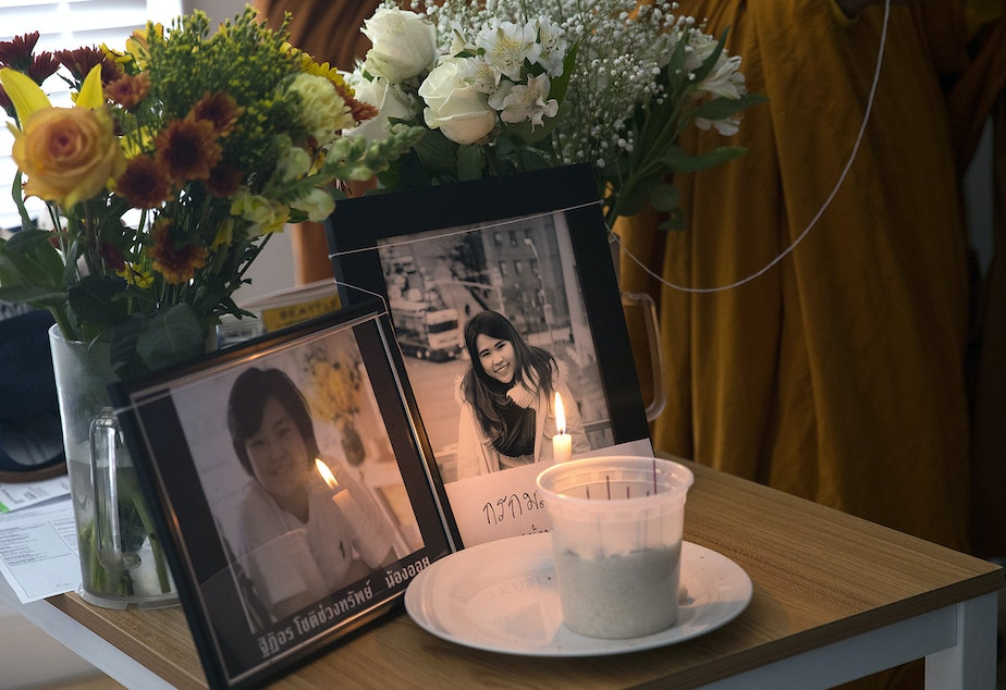 Framed pictures of Thiti-on Chotechuangsab, 32, left, and Kornkamon Leenawarat, 25, right, are shown during a dedication ceremony with the Buddhangkura Buddhist Temple of Washington, in the apartment where the two women lived, on Wednesday, September 12, 2018, in Seattle.