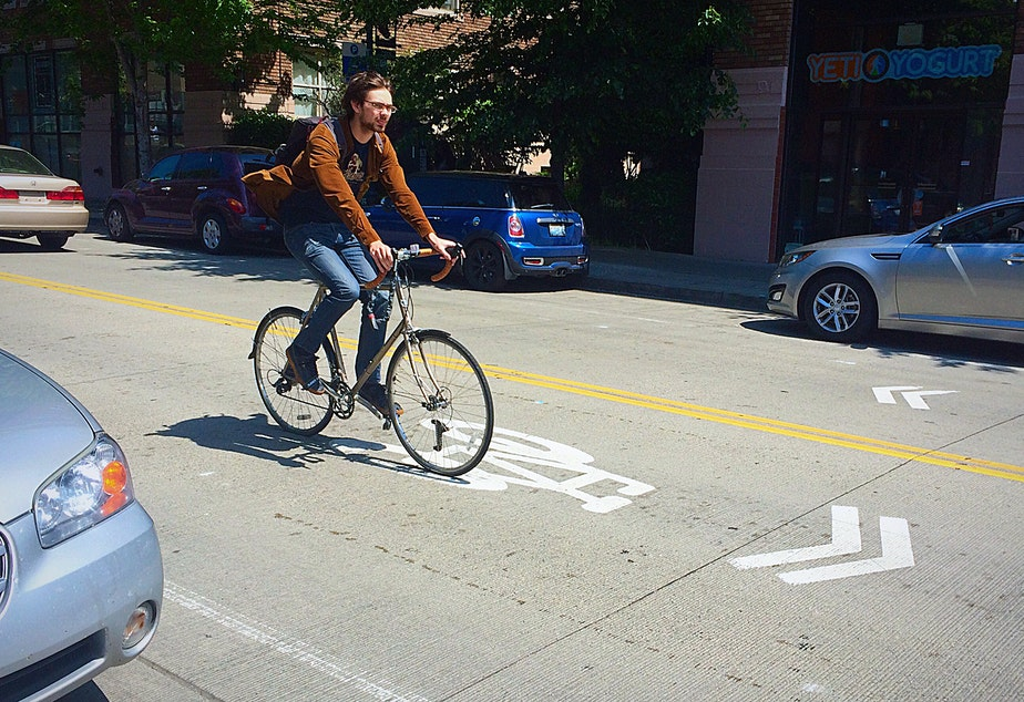 A cyclist rolls down University Way Northeast in Seattle.