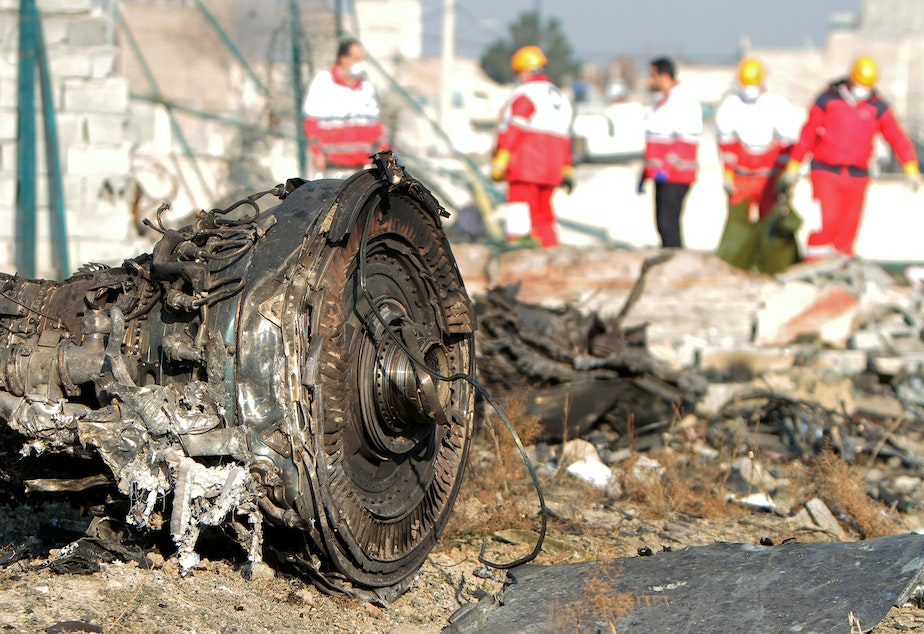 caption: Rescue crews work at the crash site of a Ukrainian airliner that went down shortly after takeoff from Tehran's Imam Khomeini International Airport on Wednesday, killing all 176 people onboard.