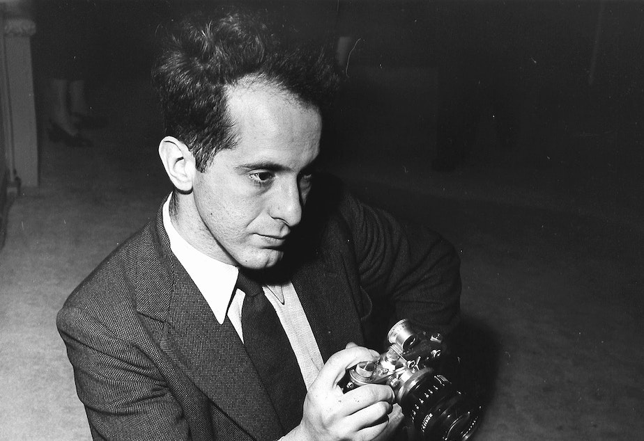 Photographer Robert Frank holds a camera in 1954. His photo book, <em>The Americans,</em> changed the way people saw photography and the way they saw the U.S.<em> </em>Frank died on Monday at the age of 94.