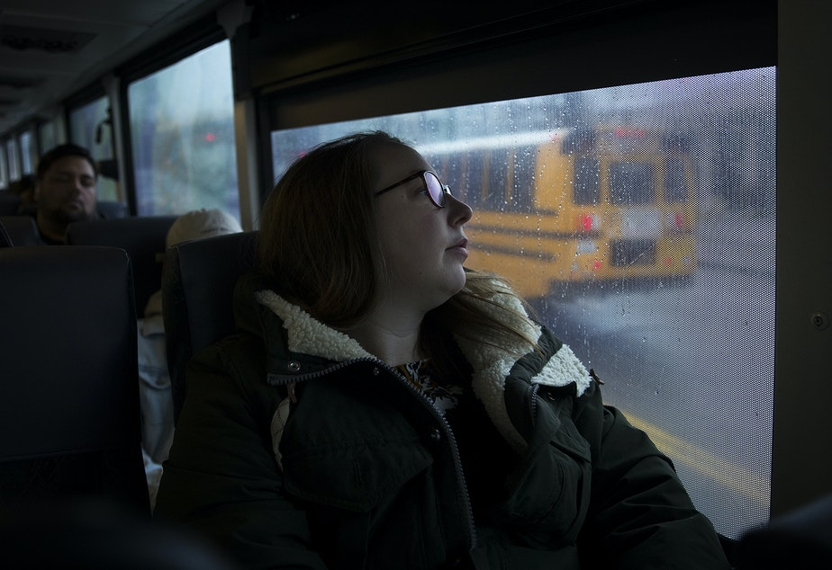caption: Kara Peters commutes to her job at the Seattle Public Central Library on the 594 Sound Transit bus from Tacoma on Wednesday, January 22, 2020.