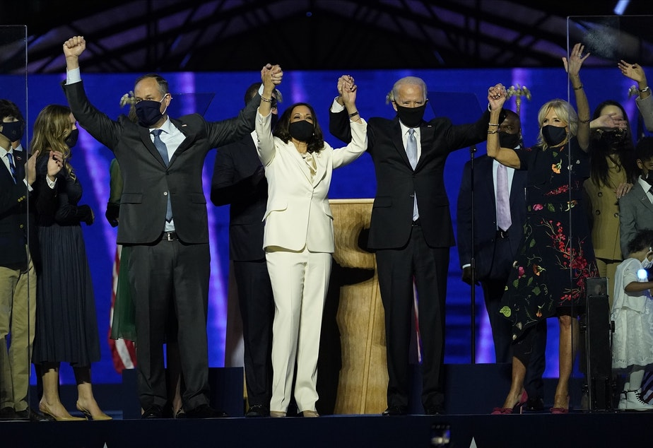caption: From left, Doug Emhoff, husband of Vice President-elect Kamala Harris, Harris, President-elect Joe Biden and his wife Jill Biden on stage together, Saturday, Nov. 7, 2020, in Wilmington, Del.