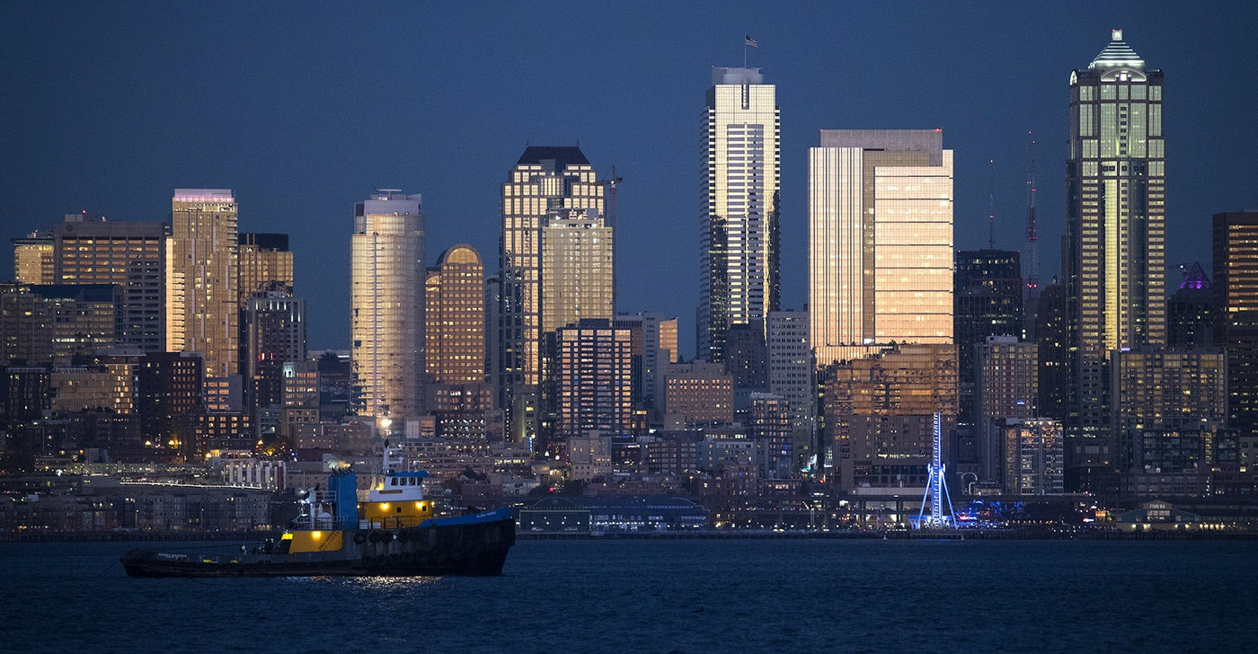 caption: The sun sets on downtown Seattle on Friday, October 27, 2017, shown from Harbor Ave. Southwest.