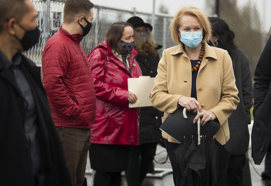 caption: Seattle Mayor Jenny Durkan leaves a press conference on Thursday, February 18, 2021, at the West Seattle Covid-19 testing site on Southwest Thistle Street in Seattle. A pop-up vaccination clinic was set up for older Latino community members who were referred by El Comite or Villa Comunitaria.