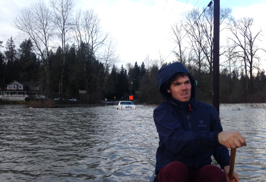 caption: Andrew Ide grapples with flooding on his farm in Snohomish.