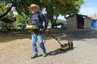 Lew Somers pulls a ground-penetrating radar instrument at Kam Wah Chung State Heritage Site