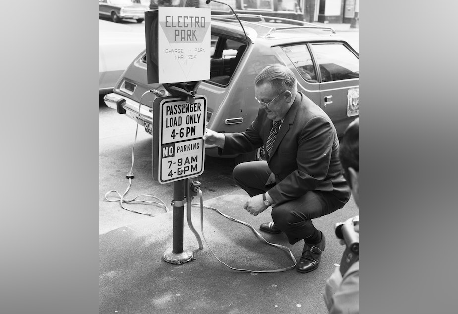 caption: City Light Superintendent Gordon Vickery with a prototype AMC Gremlin electric car, 1973