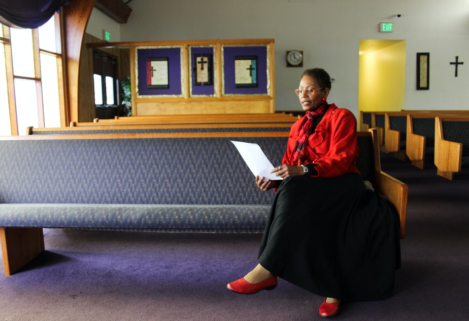 caption: Karen Shiveley, 67, waits to meet the pastor of a Baptist church in Everett. Shiveley has been checking out several churches around the Seattle area, hoping to find the right fit.