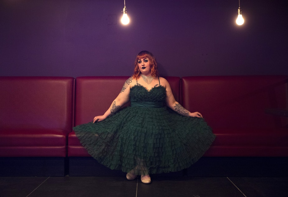 caption: Burlesque performer Penny Banks poses for a portrait on Friday, April 9, 2021, at the new Burlesque space along Northwest Market Street in Seattle.