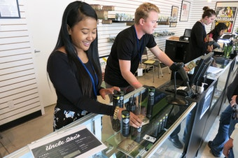 Employees at Ike's Pot Shop in Seattle's Central District sell marijuana products on their opening day, Sept. 30, 2014.