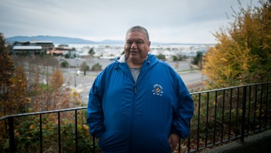 Elden Hillaire overlooking the Squalicum Harbor Marina/Bellingham Harbor Marina, Bellingham, Washington.