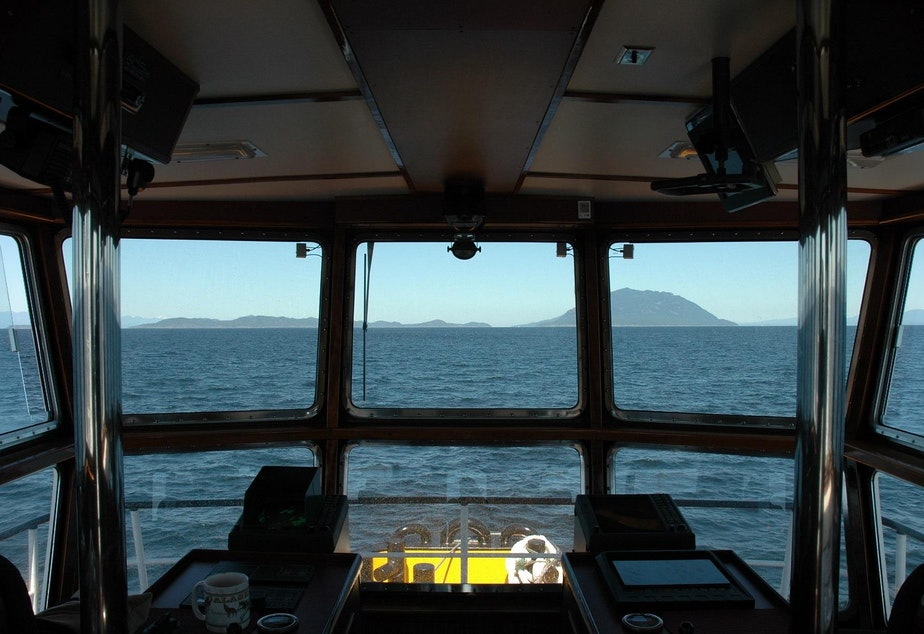 caption: The view from the wheelhouse of the Pacific Titan tugboat along the Inside Passage to Alaska.