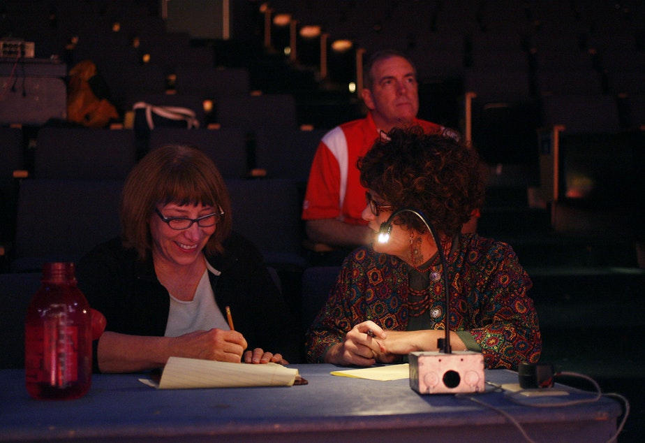 caption: Linda Hartzell, left, with SCT staff, working on an adaptation of 'High School Musical'