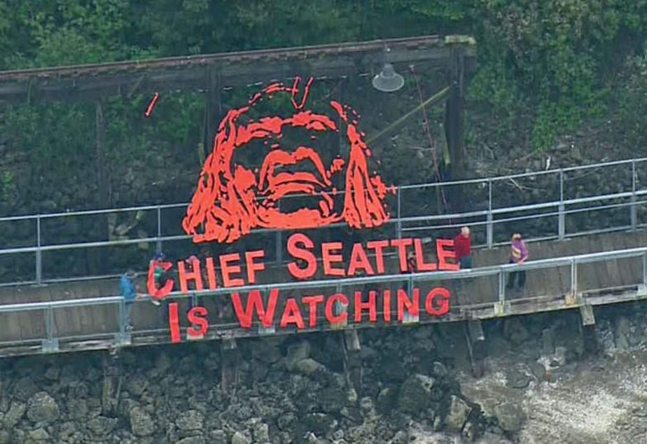 caption: Activist group Backbone Campaign hung this banner in September 2015. Chief Seattle is often quoted by environmental groups.