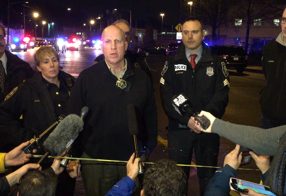 caption: SPD assistant chief Robert Merner responds to reporter questions in the SODO neighborhood after a shooting on Tuesday night.