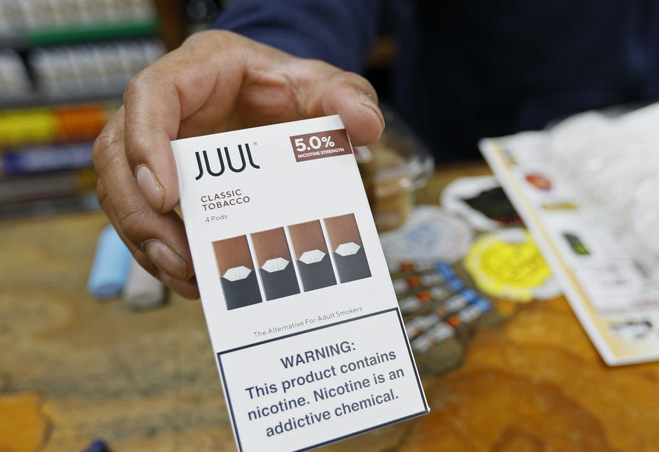 caption: Juul announced that its CEO is stepping down and the company will stop advertising its popular vaping products. The announcements come as regulators work on new rules to curb the use of flavored vaping products among young adults.
