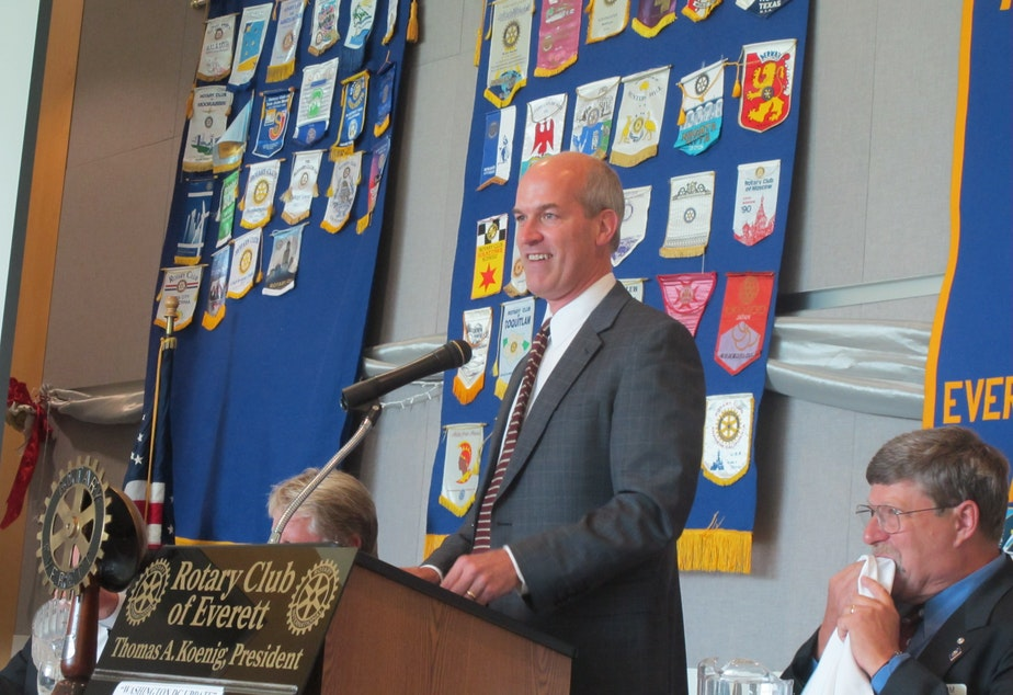 caption: Rep. Rick Larsen speaks to the Everett (Wash.) Rotary in the Grand Vista Ballroom of Naval Station Everett in late August 2011.