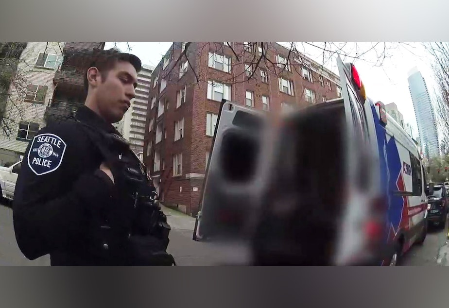 caption: A screenshot of a body camera video during a call to June's apartment. June is a frequent 911 caller in Seattle.