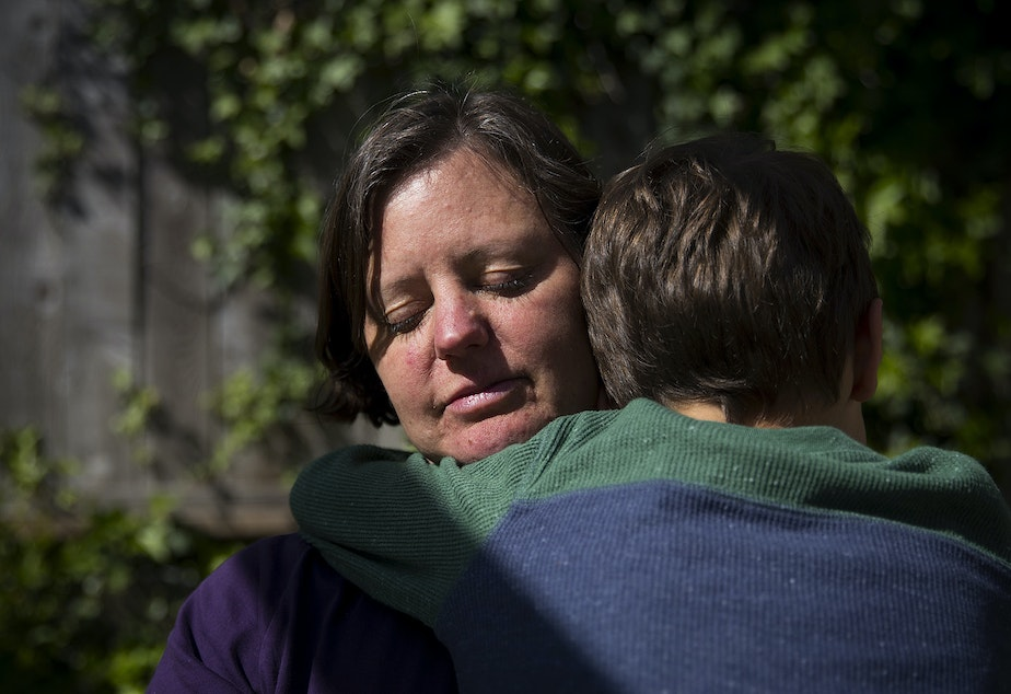"""caption: Jen Apfel of south Seattle holds her 7-year-old son Max. """"I used to feel a lot of shame around it. I have no issue talking about it at all. I just feel good about sharing those experiences if it might help someone. After my son was born I had ongoing horrible anxiety driving him across the bridge, just like being terrified every time, scared of car accidents, all the horrible images in my head."""""""