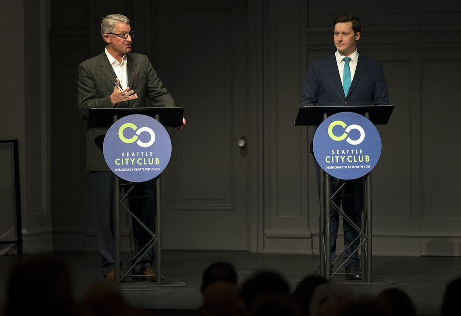 caption: Candidates for Seattle City Council in District 7, Jim Pugel, left, and Andrew Lewis debate at Town Hall Seattle. Lewis is getting more backing from labor, and Pugel is getting more backing from business.