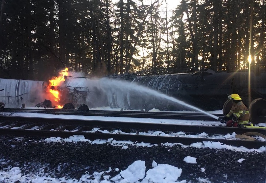 caption: A firefighter attacks a burning oil train in Custer, Washington, on Dec. 22, 2020.
