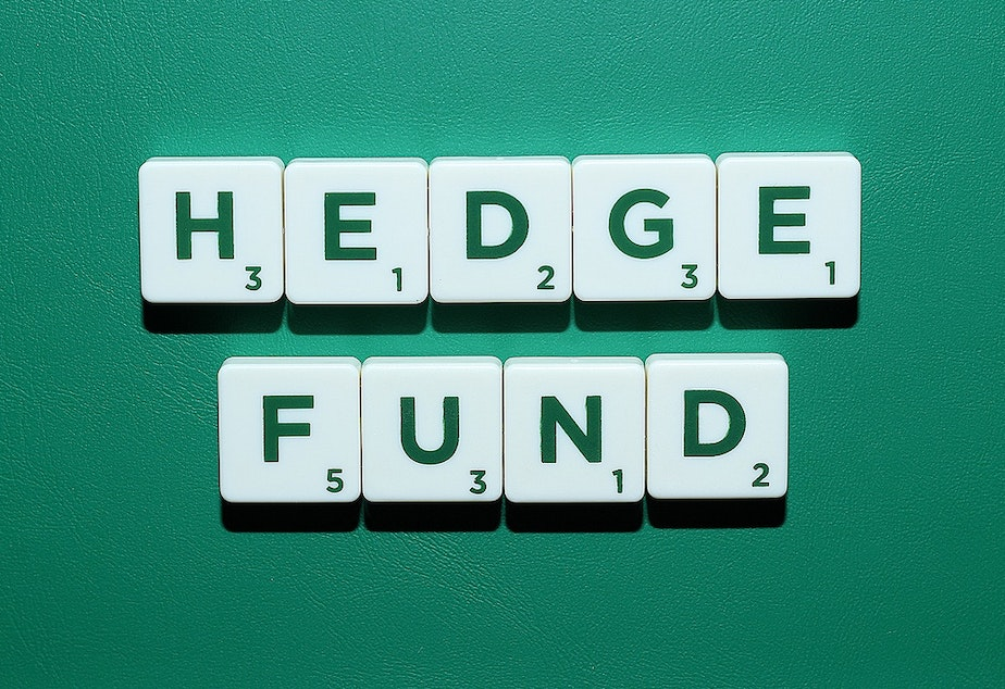 "caption: Scrabble tiles spell out the words ""hedge fund""."