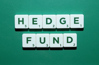 "Scrabble tiles spell out the words ""hedge fund""."