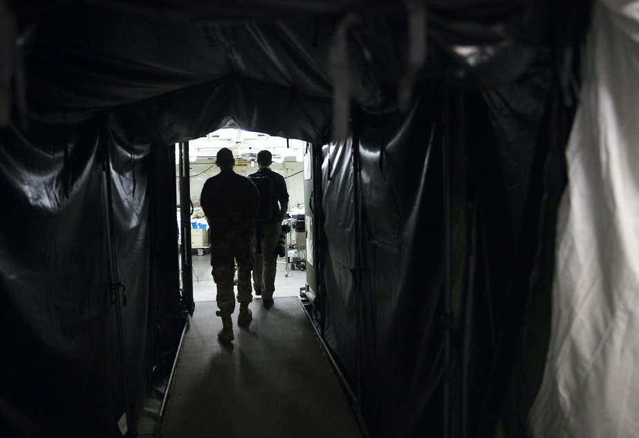 caption: A tunnel into the operating suite is shown at the military field hospital inside CenturyLink Field Event Center on Sunday, April 5, 2020, in Seattle. The 250-bed hospital for non COVID-19 patients was deployed by U.S. Army soldiers from the 627th Army Hospital from Fort Carson, Colorado, as well as soldiers from Joint Base Lewis-McChord.
