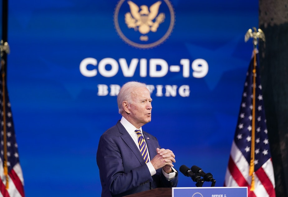 caption: President-elect Joe Biden speaks at The Queen theater, Tuesday, Dec. 29, 2020, in Wilmington, Del.