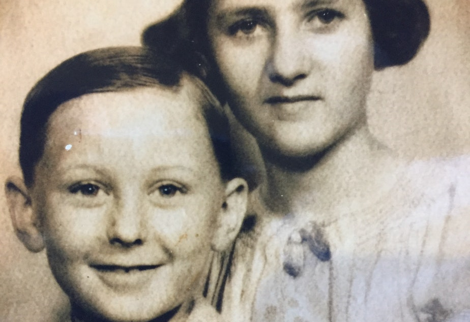 A young Werner Glass and his sister Helga pose for a portrait.