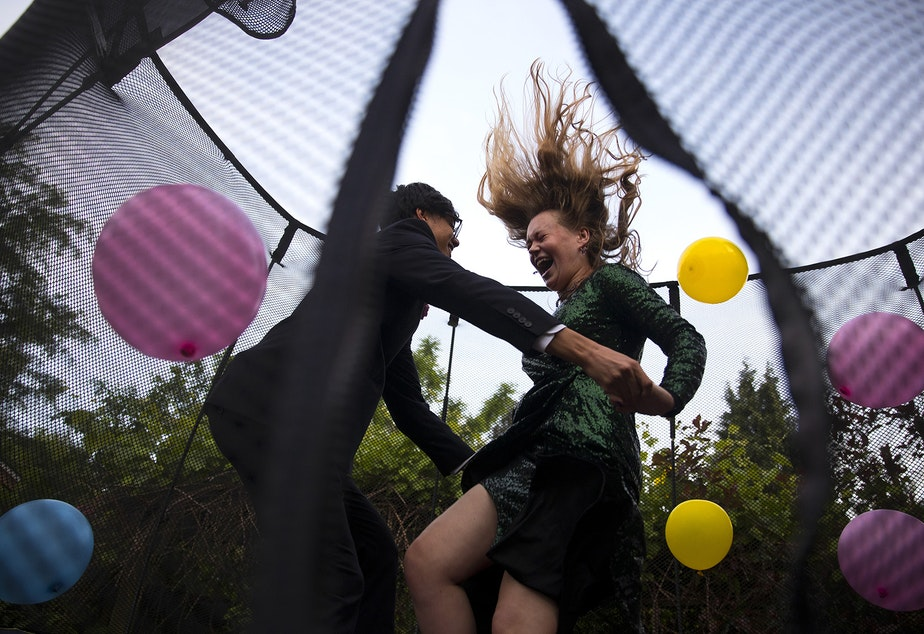 "caption: Leo Padua, a 17-year-old senior at Ingraham High School, and Morgen White, right, an 18-year-old senior at Ballard High School, jump on a trampoline with balloons during their own personal prom celebration in Leo's backyard on Saturday, May 23, 2020, in Seattle. ""It feels like a little bit of childhood that I missed,"" said White. ""It's this point where you're supposed to become an adult but it feels like it didn't happen."""