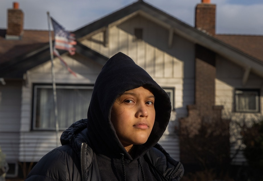 caption: Michelle Aguilar Ramirez recently moved to Spokane, Washington, from Seattle with her mom, but says she has struggled with the multiple racist incidents she's experienced since she's arrived. She walks in her neighborhood every day, but avoids certain areas where neighbors fly confederate flags or Make America Great Again signs.