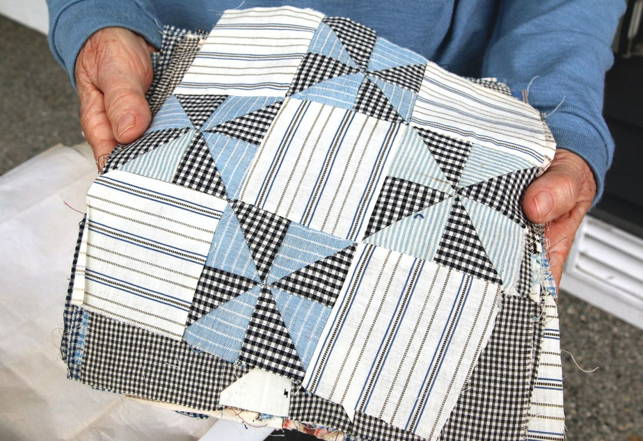 caption: The quilting squares were made from aprons, shirts and dresses
