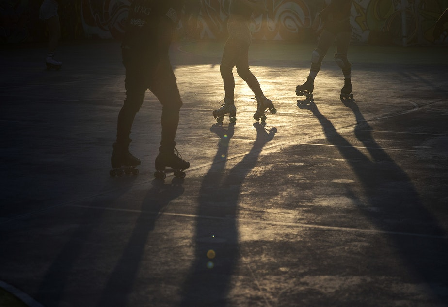 caption: People roller skate during a Roll Around Seatown skate meet up on Monday, September 28, 2020, at the Judkins Park sports courts in Seattle.
