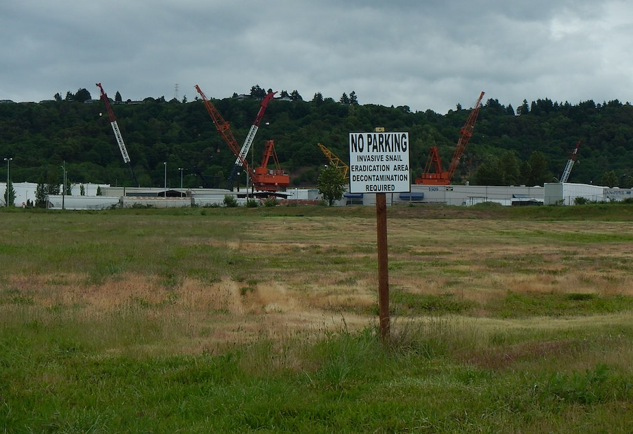 caption: A warning sign at a vacant lot at the Port of Tacoma