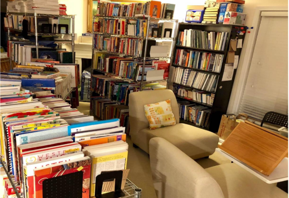 caption: Welcome to the Chuas' home library. Beware of book-alanches!