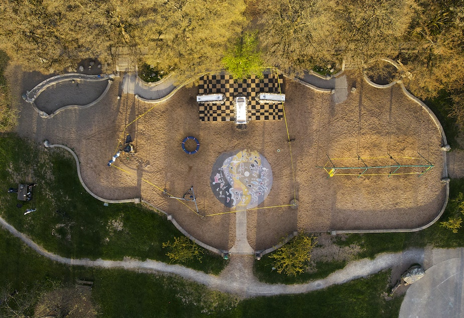 "caption: An aerial view of Meridian playground in Wallingford is shown roped off with caution tape on Friday, April 10, 2020, in Seattle. Fifteen of Seattle's city parks were closed for the weekend in an effort to slow the spread of the coronavirus outbreak. ""This is not spring break,"" said Seattle Mayor Jenny Durkan after announcing the park's closures. ""We are still in the middle of a global pandemic."" The parks reopened the following Monday."
