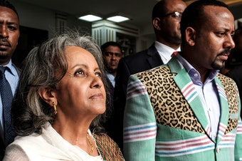 Sahle-Work Zewde walks with Prime Minister Abiy Ahmed after being appointed Ethiopia's first female president at the country's parliament in Addis Ababa on Thursday.