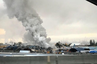 Smoke billows from a fire at the Simon Metals scrapyard in Tacoma on Monday.