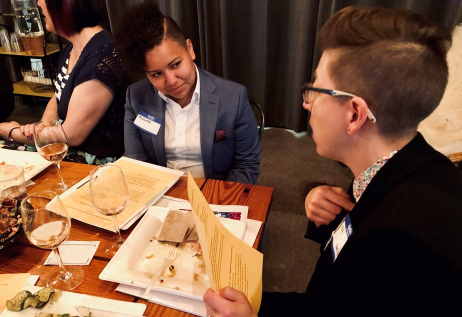 caption: Mellina White Cusack (left) listens while in-conversation with fellow Queeriosity Club member Keri Zierler at The Cloud Room in Seattle. June 6, 2019